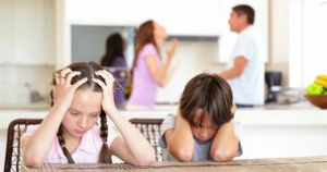 sad-children-listening-to-their-parents-fighting-home-kitchen-43913612